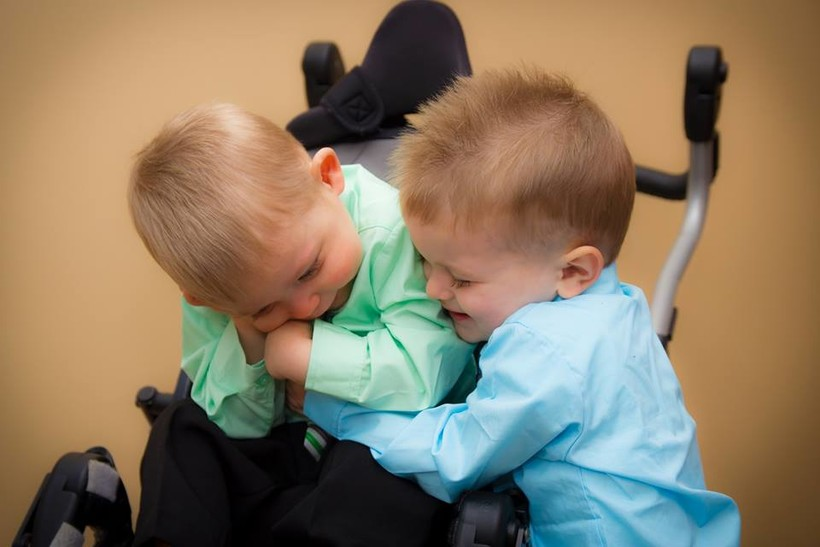Josiah Hoerter, left, gets a hug from his brother Isaiah