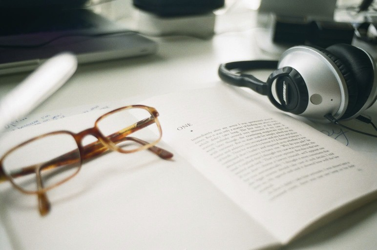 audiobooks, reading, glasses, headphones,