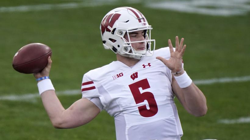 Wisconsin quarterback Graham Mertz throws a pass