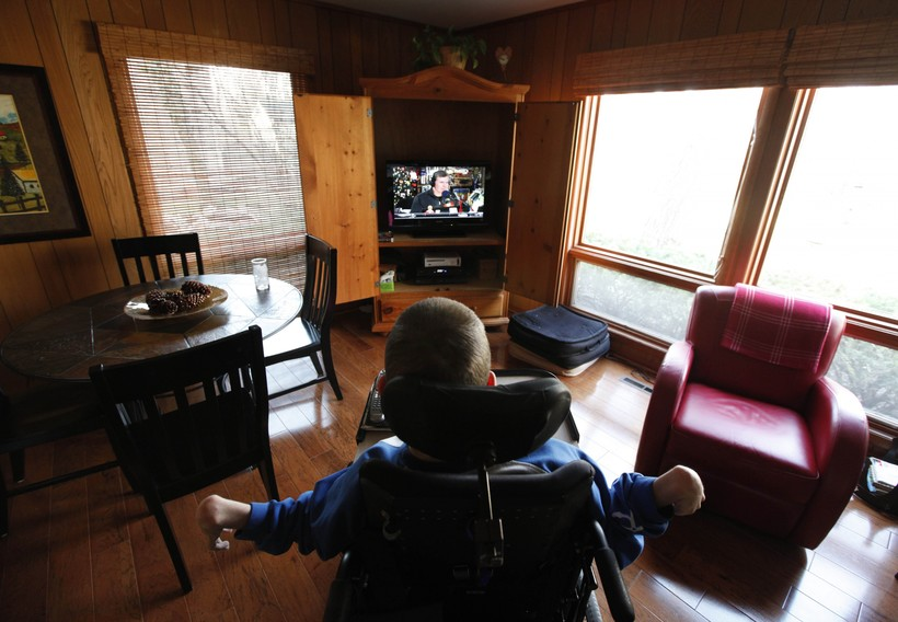 Mike Berkson, a 22-year old with cerebral palsy, watches tv
