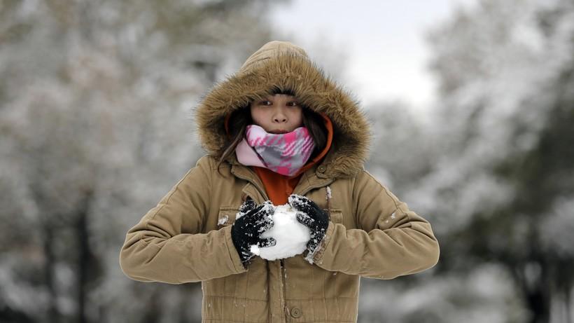 Woman makes a snowball