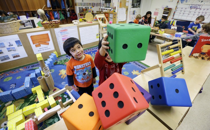 Daniel O'Donnell looks on as William Hayden sends large blocks flying at the Creative Kids Learning Center