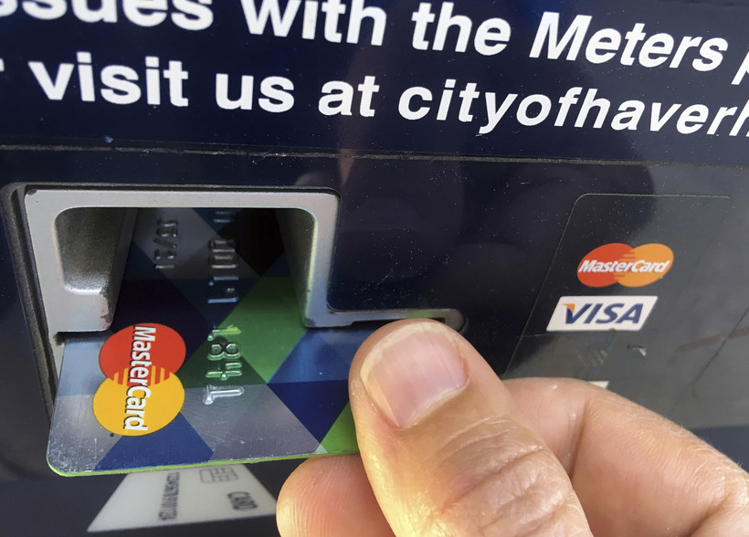 Credit card inserted into parking meter