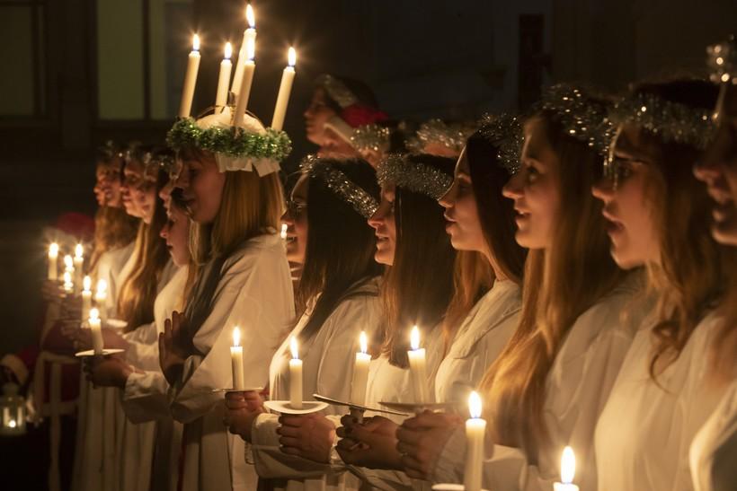 Young women sing carols