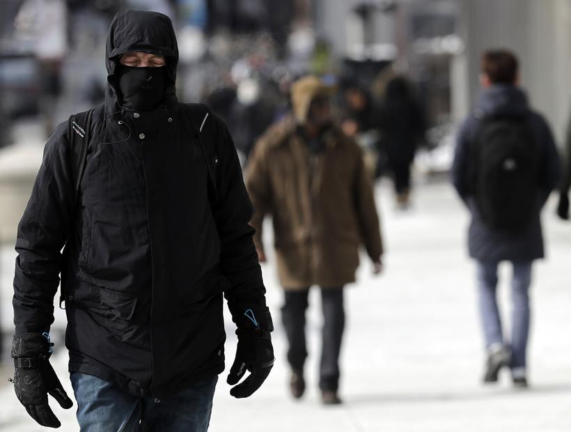 man walking in the winter