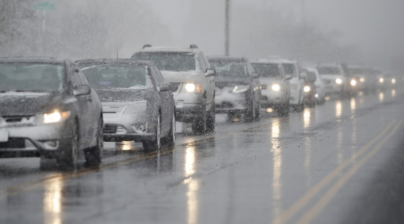 Traffic backs up as a spring winter storm rolls in