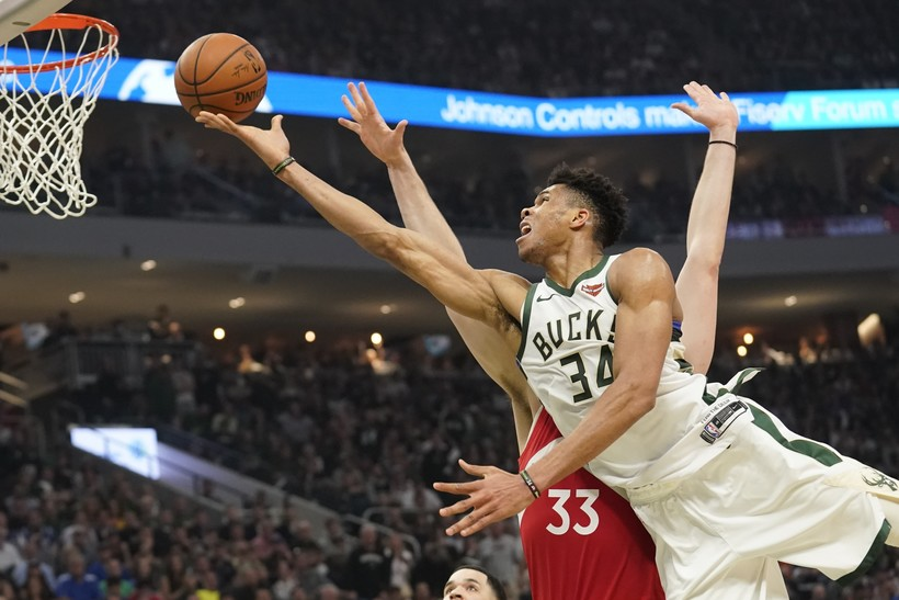 Milwaukee Bucks' Giannis Antetokounmpo shoots past Toronto Raptors' Marc Gasol