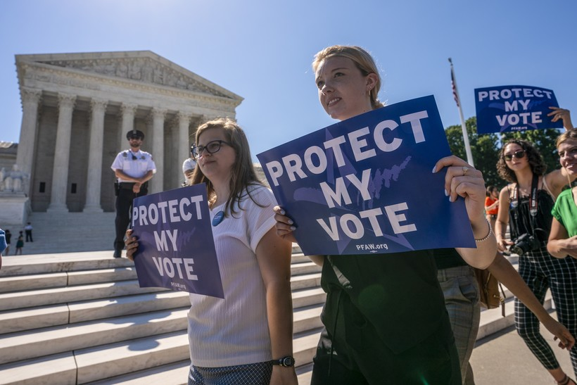 Anti-gerrymandering demonstrators gather at the Supreme Court
