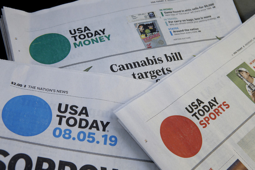 Sections of a USA Today newspapers rest together