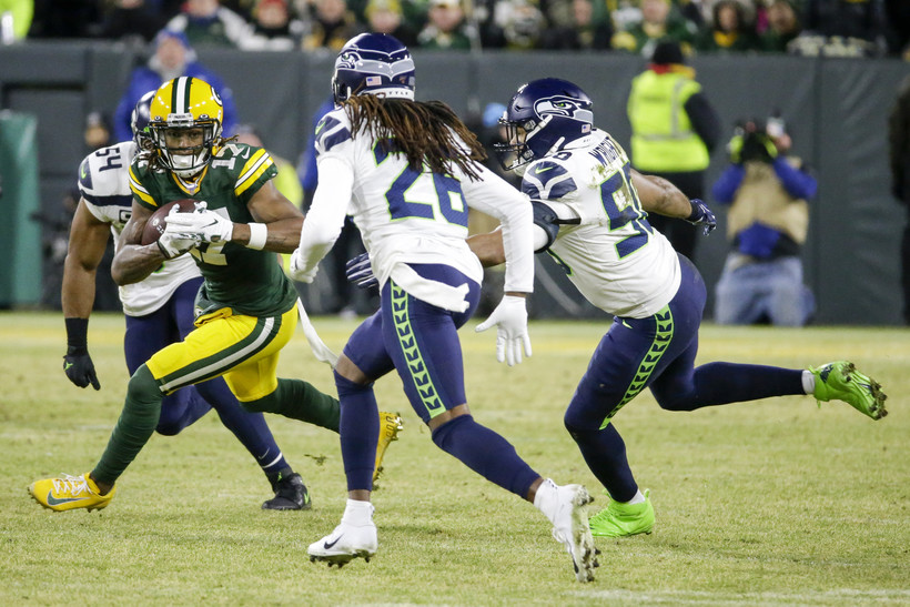 Davante Adams of the Packers runs after a catch in an NFC divisional-round playoff game.