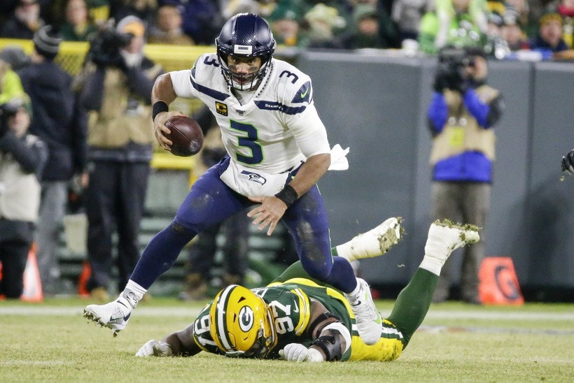 Seattle Seahawks quarterback Russell Wilson makes a play in an NFL playoff game