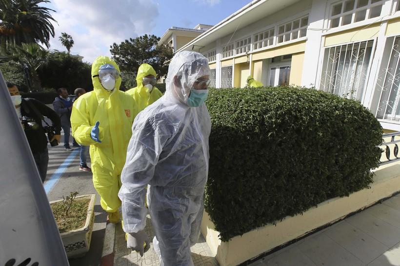 Medics walking outside clinic.