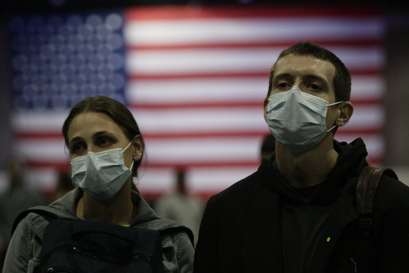 Political rally attendees wearing face masks