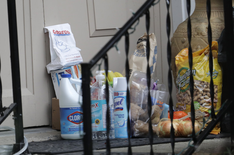 Groceries, cleaning supplies, prescription medicine and other items are shown on the front porch