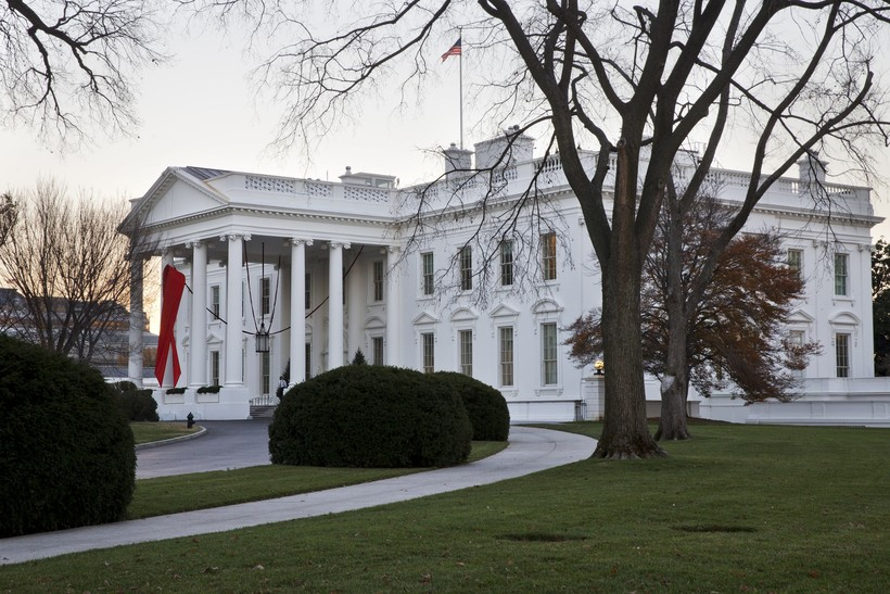 The White House is decorated with a red ribbon in honor of World AIDS Day