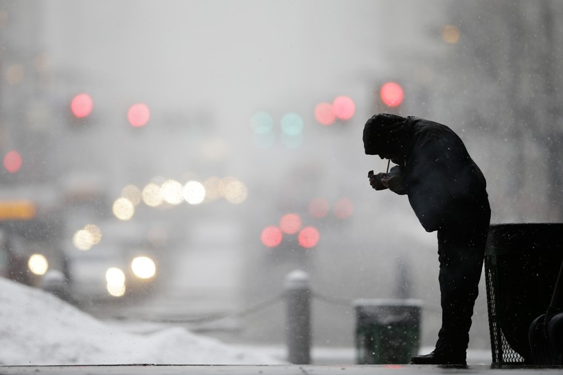 A man lights up a cigarette in winter