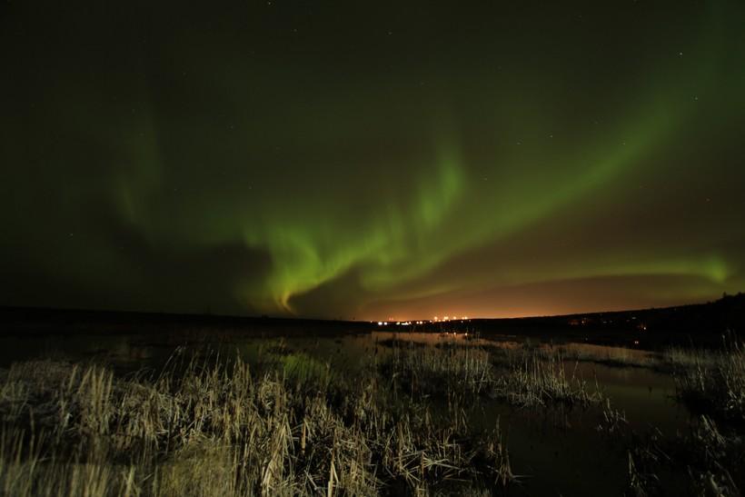 Northern lights (aurora borealis) illuminate the sky