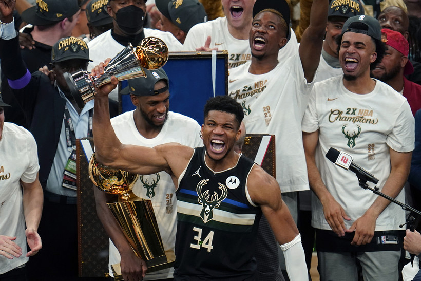 Milwaukee Bucks forward Giannis Antetokounmpo with the championship trophy