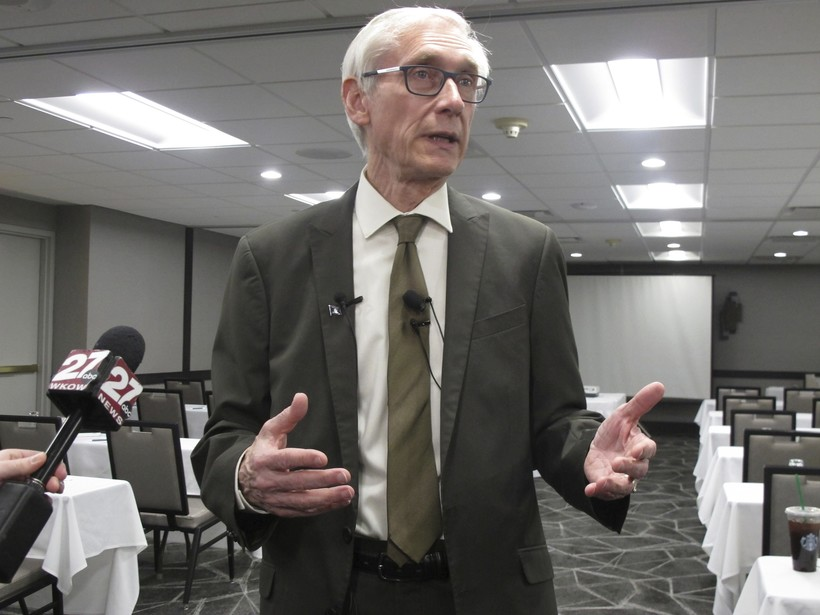 Tony Evers speaking to reporters