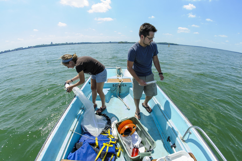 Jake Walsh and an undergraduate student use zooplankton nets to collect water samples from Lake Mendota in 2012