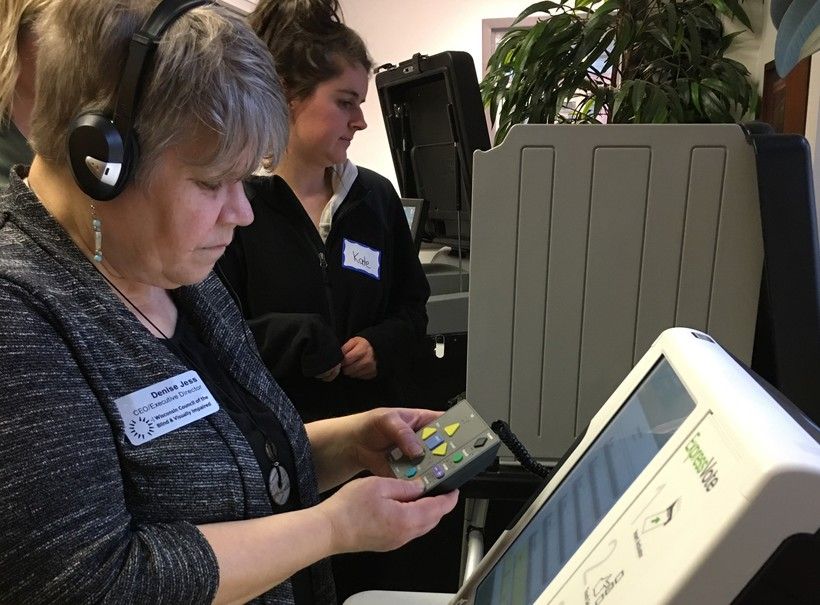 Blind individual uses ballot marking device to vote in-person