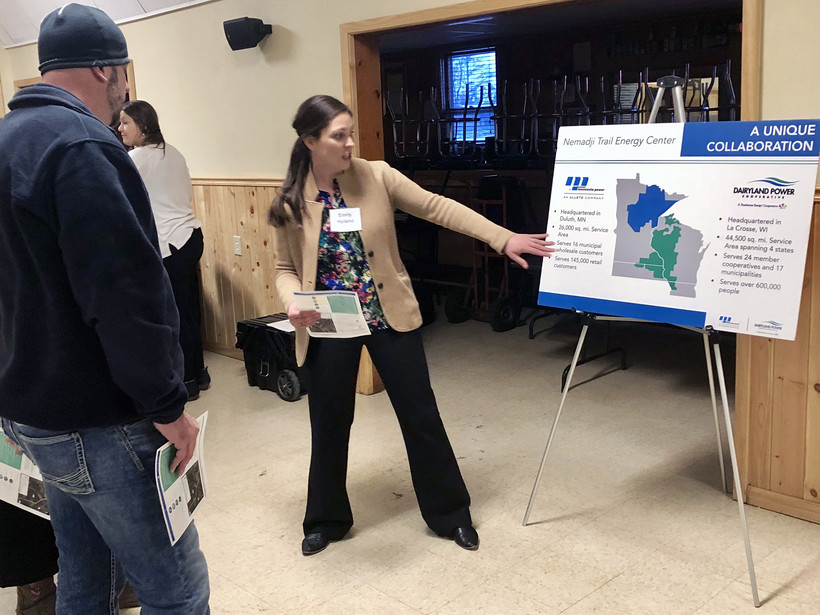 Emily Hyland talks with people about the proposed natural gas plant