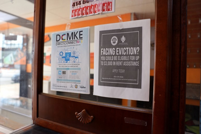 A sign advertises for emergency rental assistance