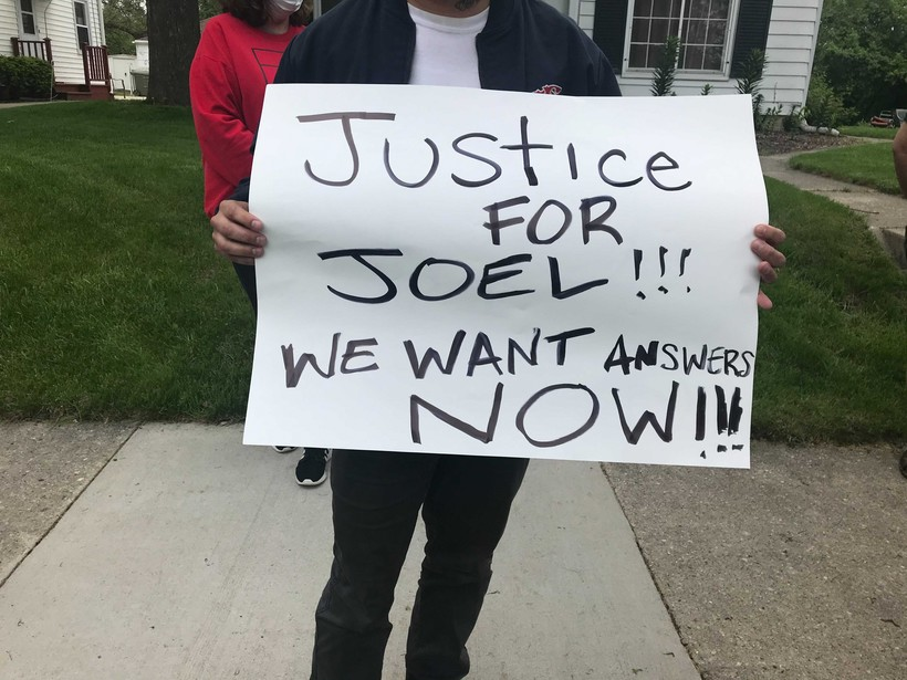 People gathered outside of Milwaukee police officer Michael Mattioli's home after the killing of Joel Acevedo