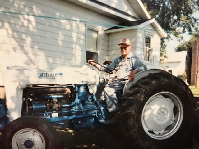World War II veteran Edward Anderson on a tractor