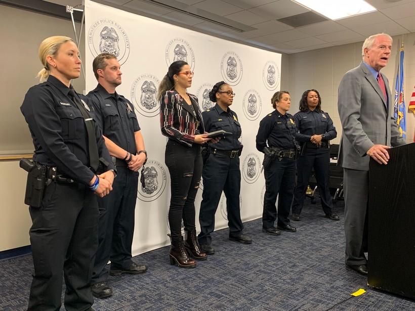 Milwaukee Mayor Tom Barrett and several Milwaukee police officers