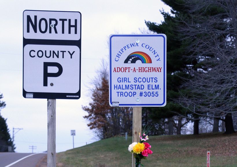 Adopt-A-Highway sign listing the Girl Scout troop that was struck