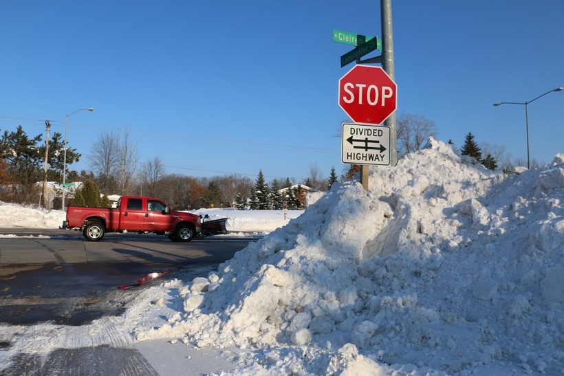 Snow piles up on Clairemont Avenue in Eau Claire