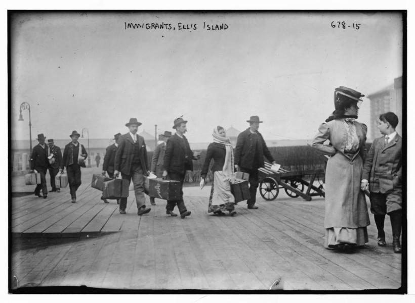 Immigrants Carrying Luggage on Ellis Island