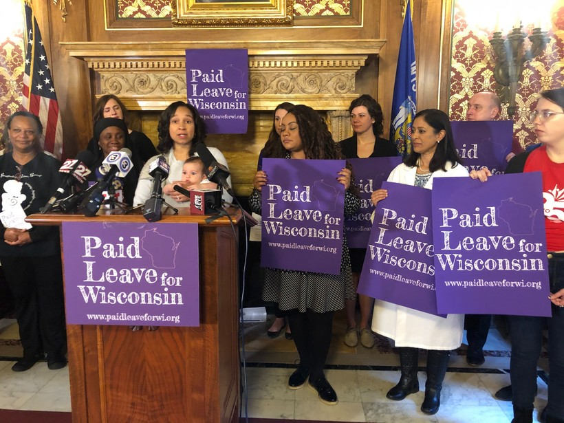Tia Murray, CEO of Harambee Village Doulas, speaks at a Capitol press conference
