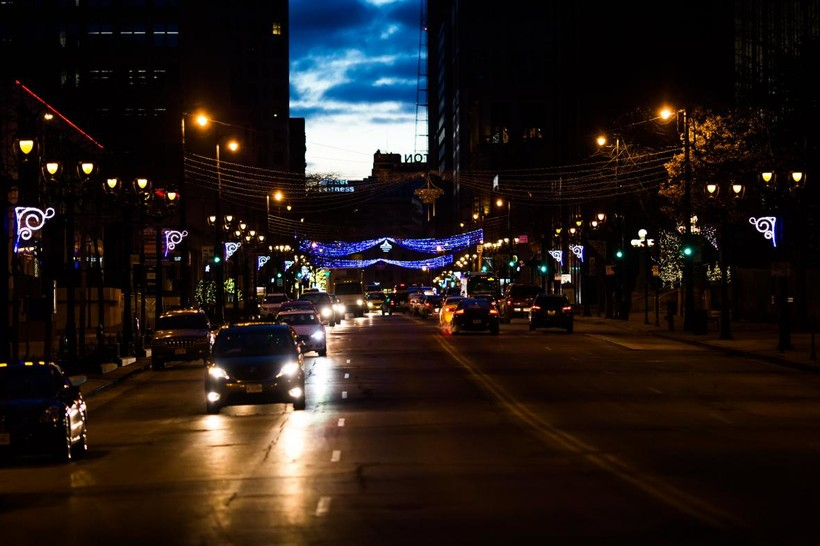 Cars drive at night in downtown Milwaukee