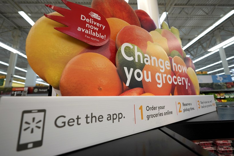 Walmart promotional sign for online grocery service
