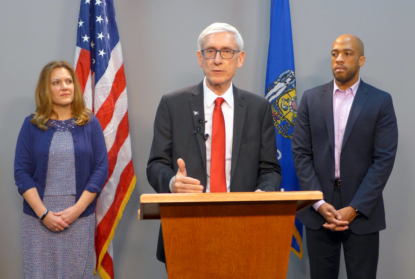 Gov. Tony Evers, joined by DHS Secretary Andrea Palm, left, and Lt. Gov. Mandela Barnes
