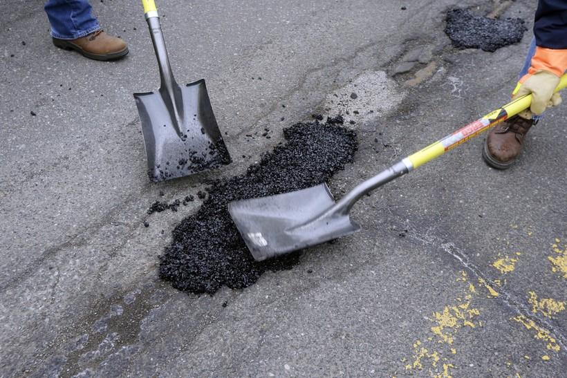 Road construction fills a pothole