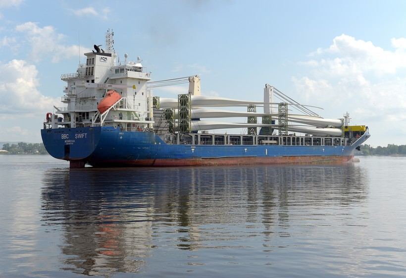 A large cargo ship, the BBC Swift, carries wind turbines into the Port of Duluth-Superior