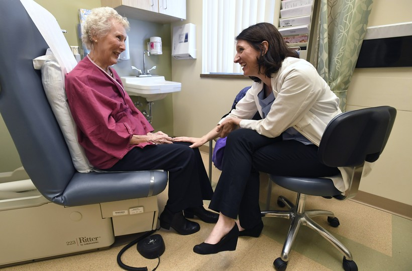 Dr. Allison Magnuson, left, speaks with patient Nancy Simpson