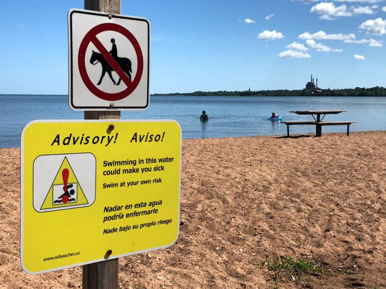 A sign warns of the risks of swimming at Lake Superior's Maslowski Beach