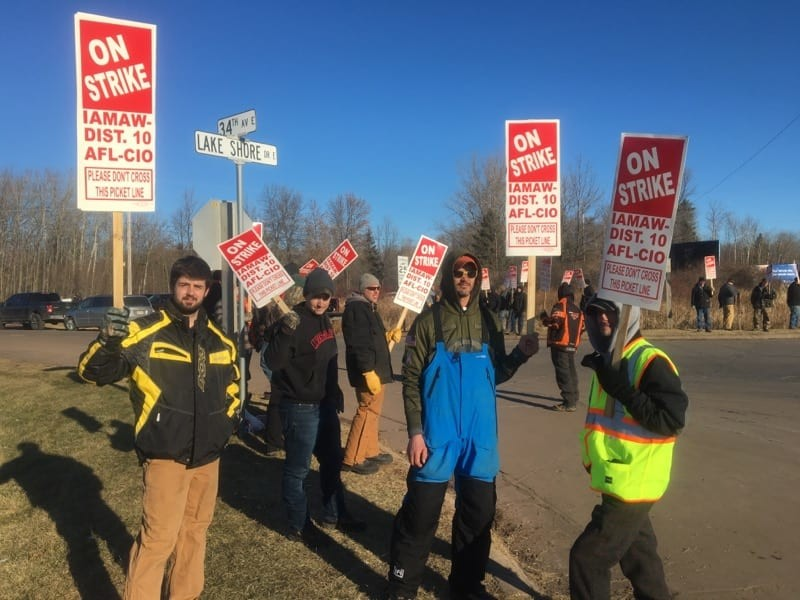 Employees picketing outside Bretting Manufacturing