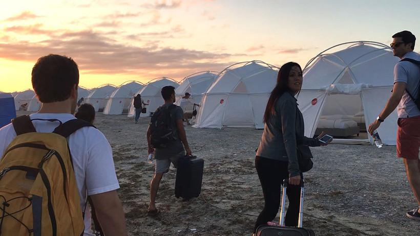 fyre festival attendees on the beach