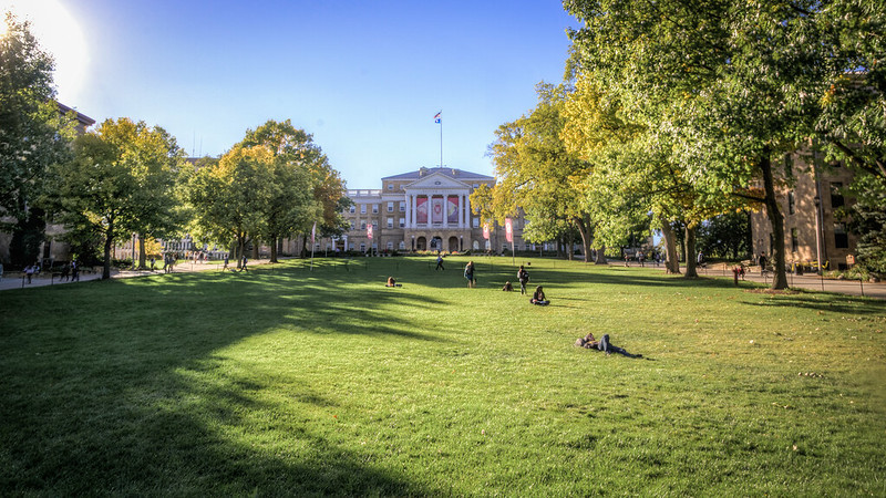 Students siting on the hill in front of Bascom Hall at UW-Madison.
