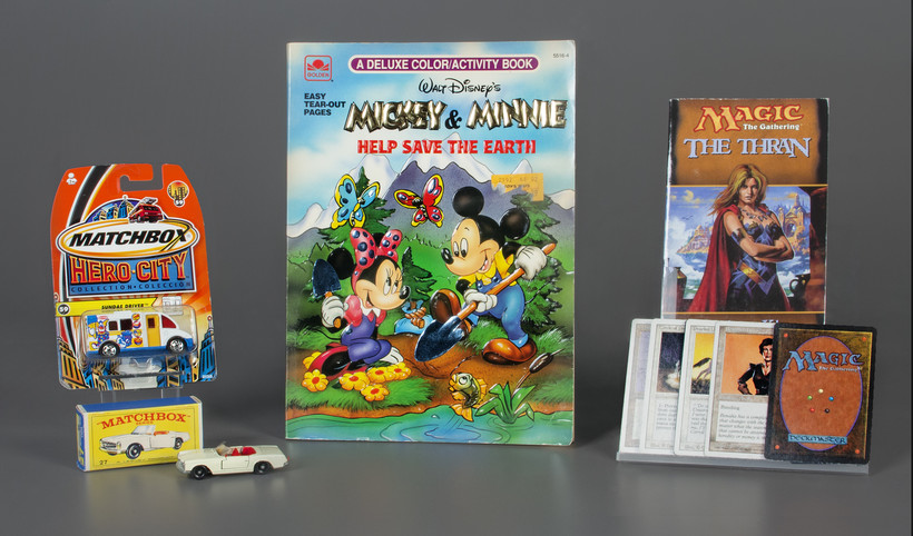 The 2019 inductees to the National Toy Hall of Fame: Matchbox Cars, Magic: The Gathering, and the coloring book.