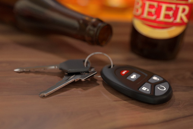 beer with keys on table