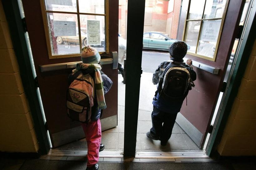 Children going out building doors