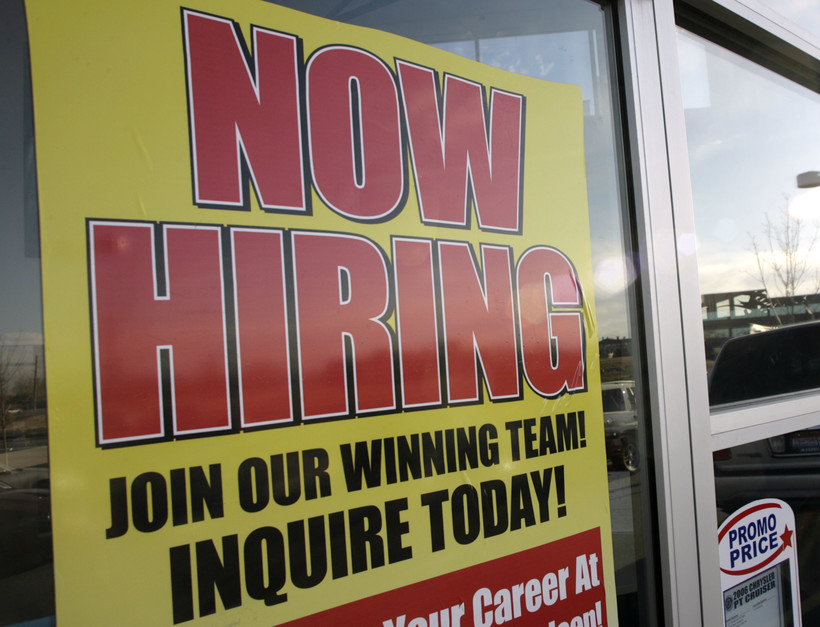 'Now Hiring' sign