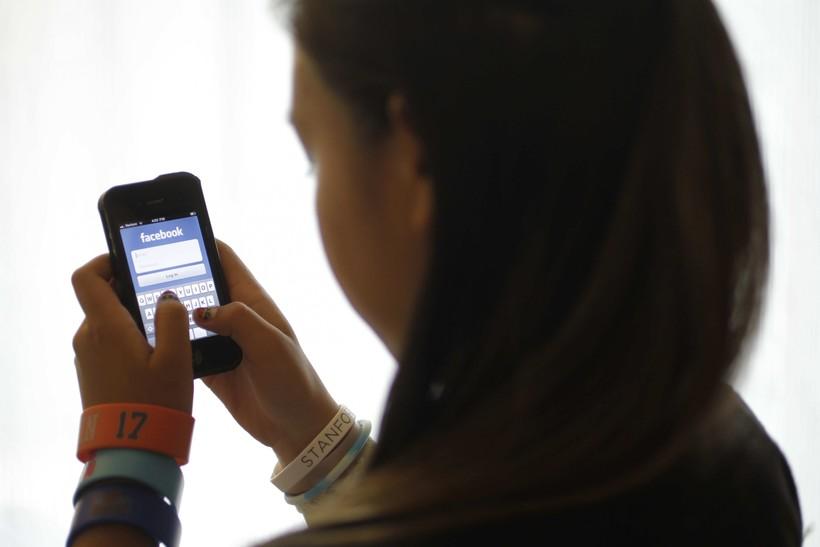 Child using social media on phone