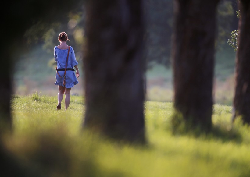 Woman walking in woods